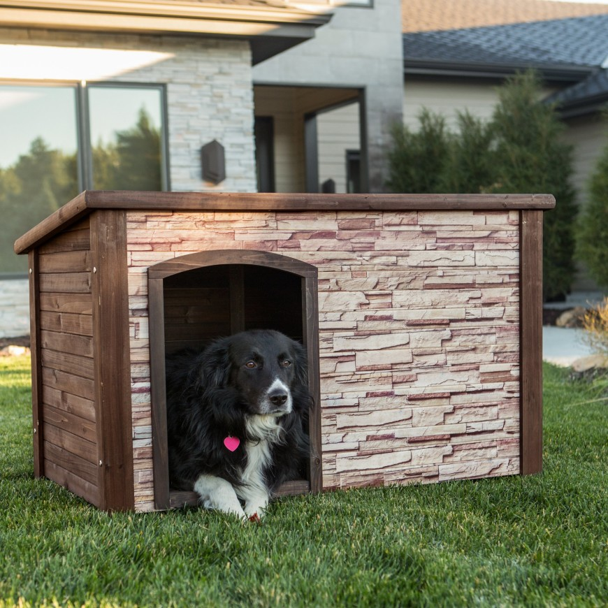 This wood and layered stone veneer dog house has a mid-century modern look to it with a flat, sloping roof without any overhang.