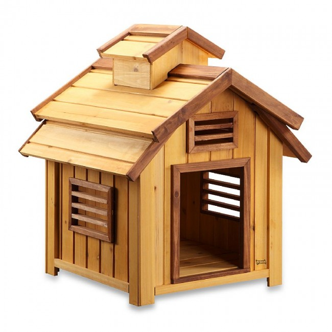 A cute dog house in wood that is designed to look like a cute birdhouse. This is a great option for very small dogs, although they should not be left outside in the dog house for long periods of time.