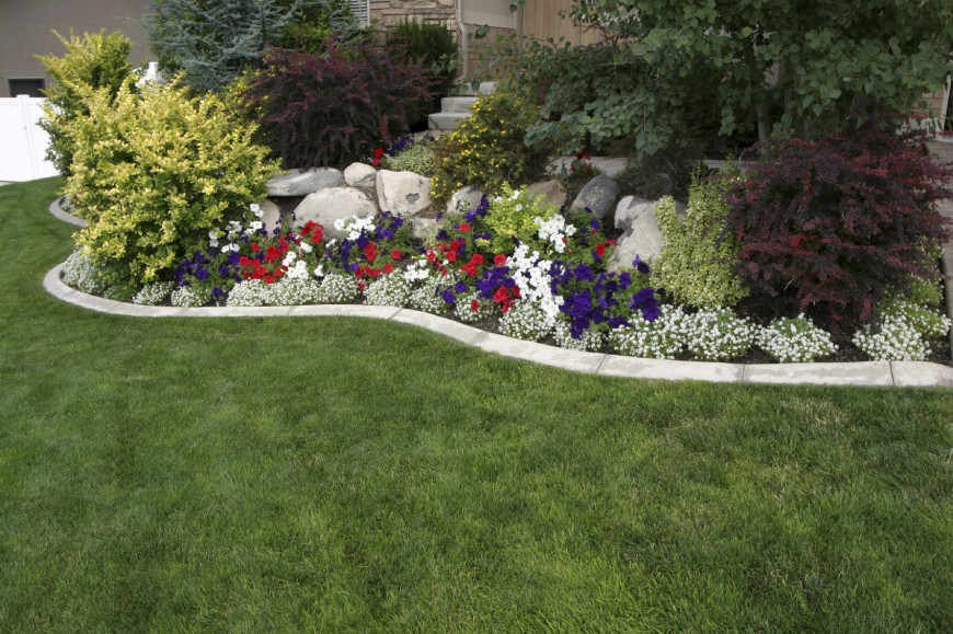 Shrubs Are A Great Accent To Other Features This Landscape Has Rock And Flower