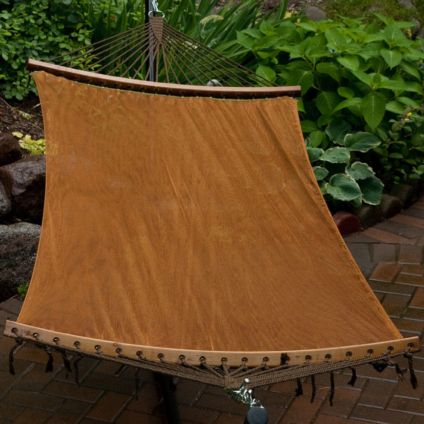 A Sheer Mesh Spreader Bar Hammock In A Rich, Warm Brown. It Stands