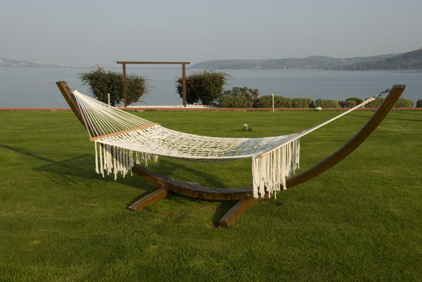 A Free Standing Spreader Bar Hammock With Sleek Wooden Frame That Would Be