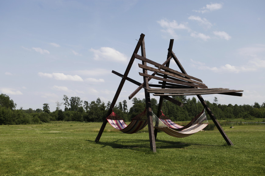 This twisted-looking structure supports three hammocks for group napping.
