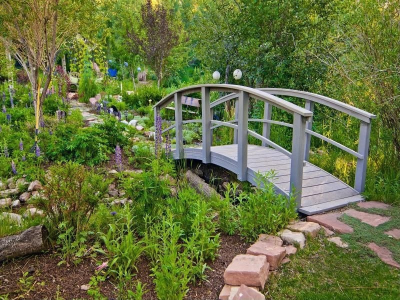 Arched bridges are often made from wood. Many times you will see the bridges stained or painted darker. Many of them will be dark brown or black with a few red accents, though there are bridges that are simpler and lighter in appeal.