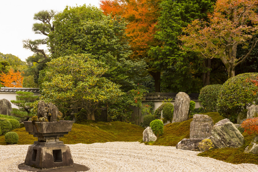 Here is a zen garden with a lovely old stone lantern in the center. This lantern illustrates that the principles of wabi/sabi can still be shown in a zen garden. This piece is a perfect example of these principles in action.