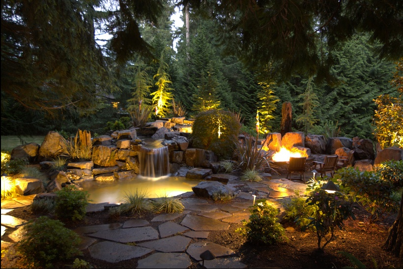 A combination of well lights and underwater lights can give a backyard a glowing effect. This warm and welcoming ambiance makes it feel as though light is erupting from the ground.
