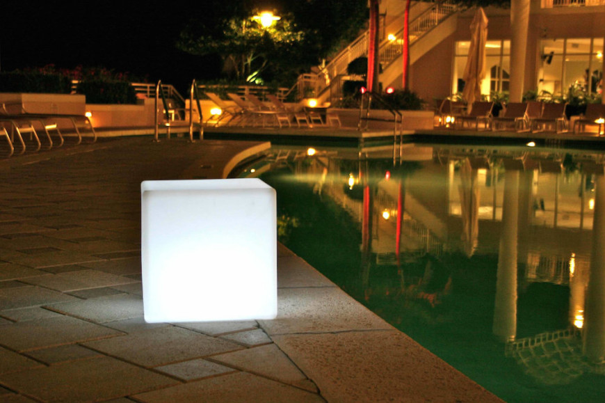 This cute outdoor lamp has a unique visual appeal. The light cube casts light in every direction. It also gives your backyard area a special draw.