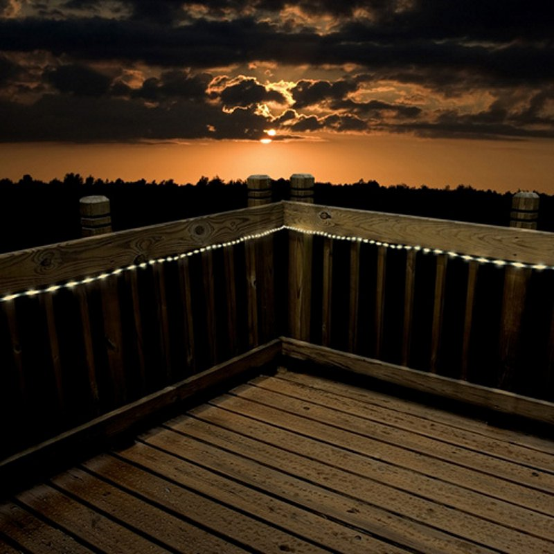 A string of LED lights is an amazing option for lining features of your back yard. This deck has a string of LEDs around the railing which perfectly outlines the space.