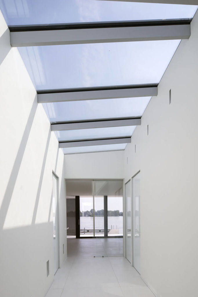 The central hall in the home is flush with bright natural light, courtesy of massive skylights and an open design that allows light to scatter from one area to the next.