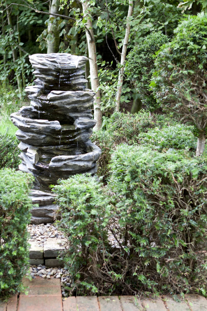 This sculpture was designed to be part of a water feature and to emulate a natural occurrence as much as possible. Not all sculptures are designed to stand out, some, such as this one, are designed to blend in and look natural.