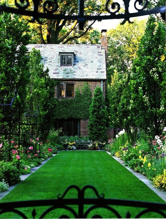 One use for a large garden is to outline a lawn. Here we see a well manicured lawn area outlined by an amazing and lush, large garden. The garden works to build the boundaries of the lawn.