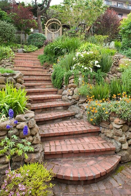 If you have a stone pathway or steps that you want dressed up snazzy you can use a large garden to accentuate these paths and steps. Large gardens can keep people on the path and headed in the right direction.