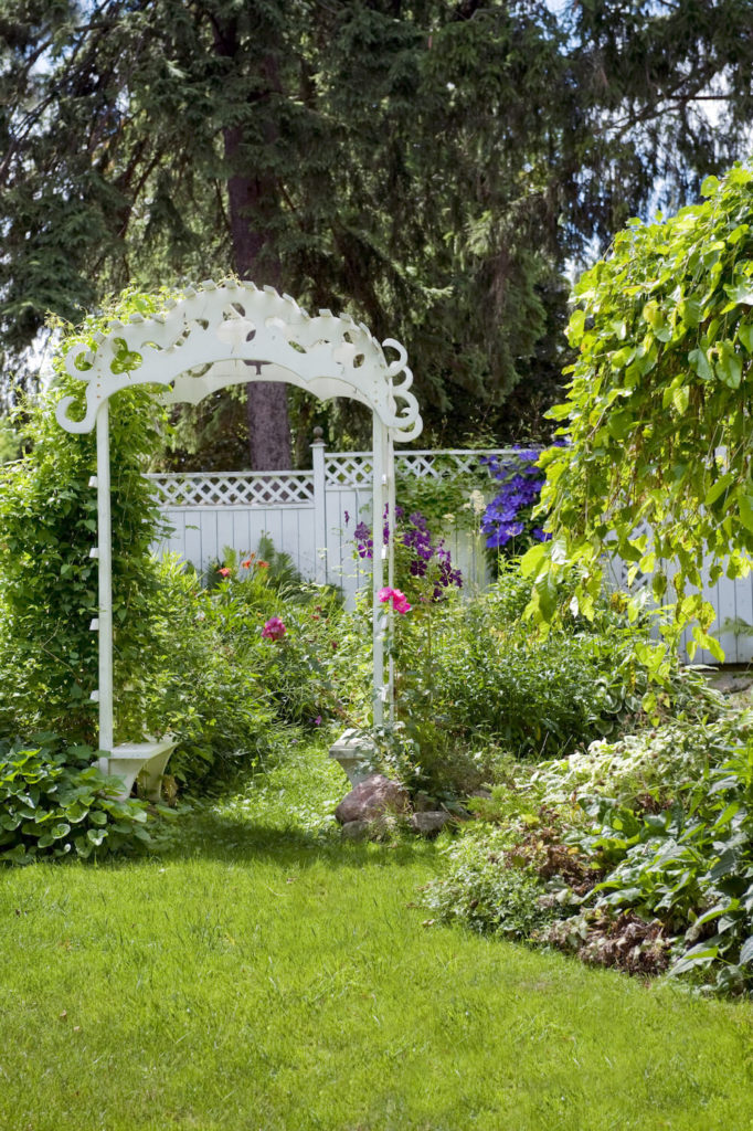 A vine covered archway is the perfect entrance to a garden area. It sets the tone and lets those who are entering your garden feel as though they are being transported to another place entirely.