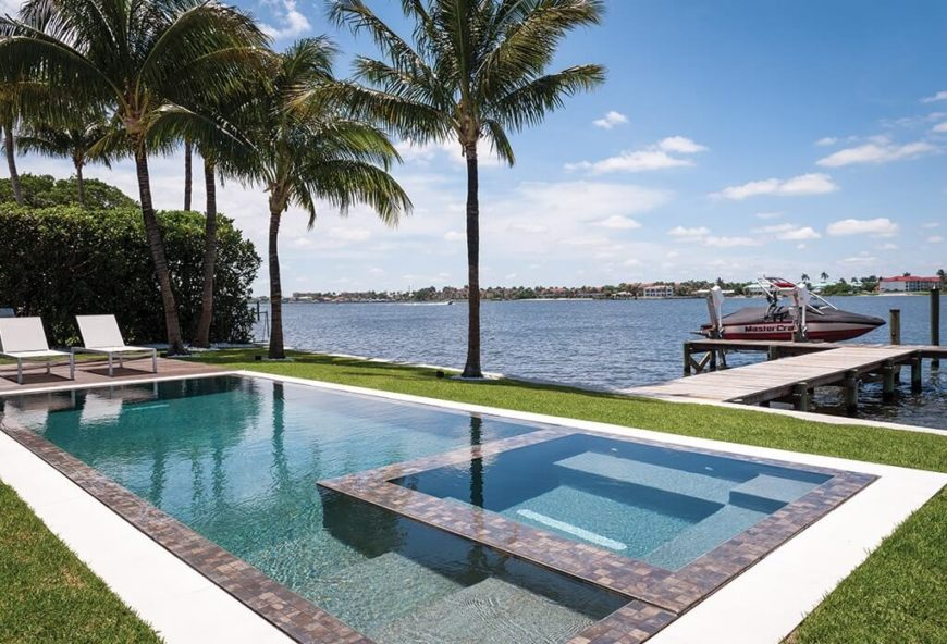 When you have a pool that is near a lake a palm tree is the perfect feature to place between these two bodies of water.