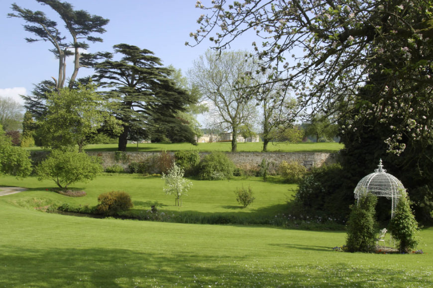 A Few Trees Dotted Across A Large Yard Can Break Up Wide Open Spaces.  Putting