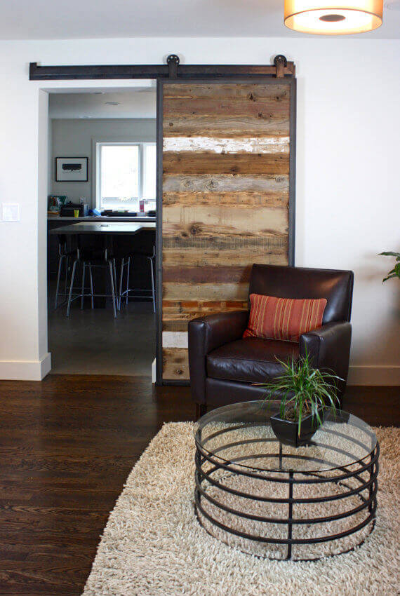 Using different sources of wood to create a sliding barn door results in a door with surprising contrast and texture.