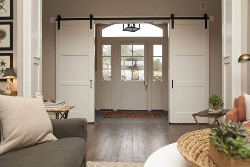 Barn Door Ideas Part - 46: These Much More Contemporary White Versions Are Used To Create A French Door-esque  Entryway