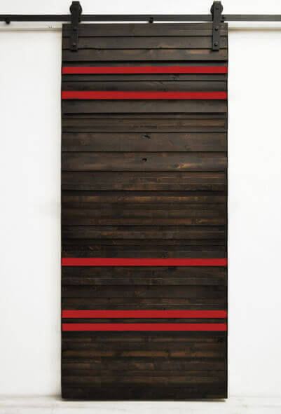 This rich dark wood barn door has bold red sections placed at alternating distances, and would be perfect in a modern or contemporary home.