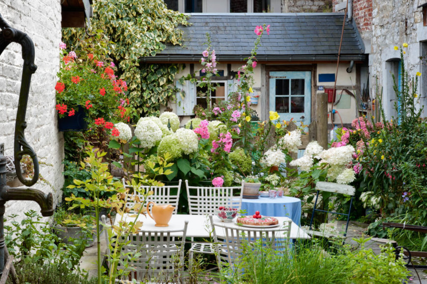 this small space is teaming with a plethora of flowers and plants just because a - Small Garden Design