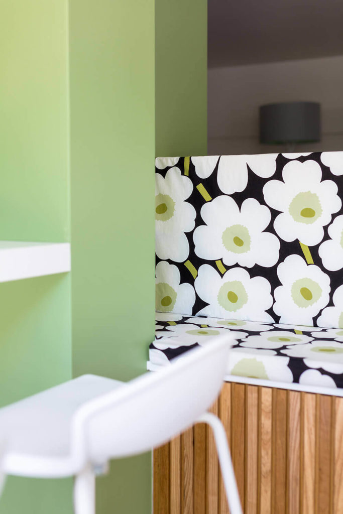 Here's a close look at some of the light green wall tones and floral patterns found throughout the home. They mesh with the natural wood accents perfectly, for a warm, inviting look.