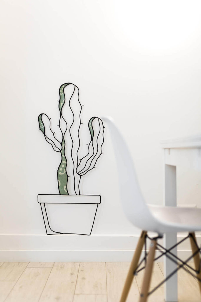 Here's that aforementioned cactus art, hanging proudly on the wall and providing a stylistically coherent addition to the visual space.