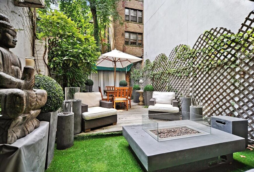 When you don't have to worry about lawn maintenance you can put interesting features in your space. Here are some cool statues and tables that would be a real issue if not for the ease of the astroturf.