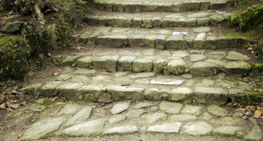 These steps are composed of many smaller stones crafted and put together. This collective look has a very natural appeal that brings both asymmetry and an organized form of nature to the set.