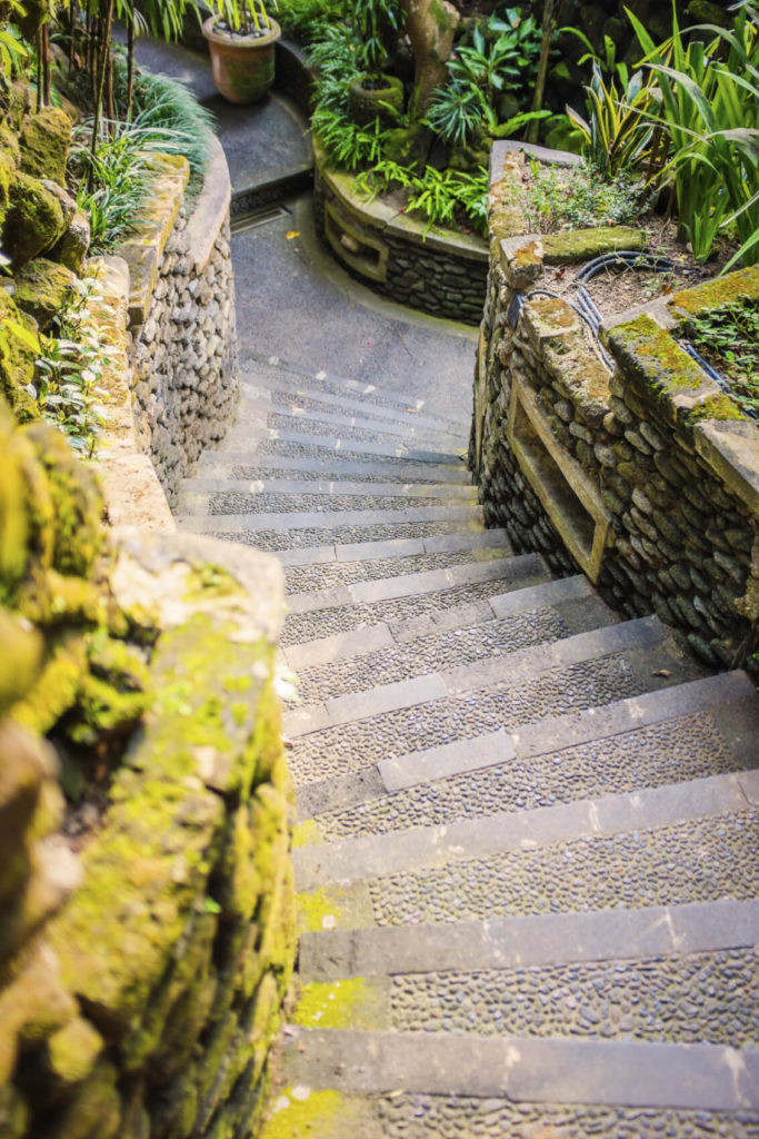 This interesting set of stairs combines well carved, cleanly designed steps with rugged and rustic walls made from stacked stones covered in moss. Even though these two designs are different characteristically, they combine well.