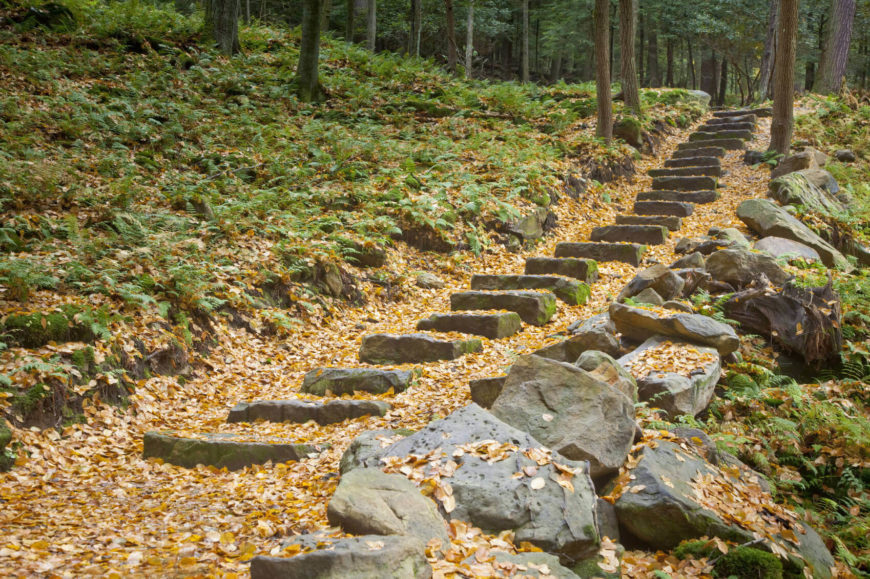 This set of stone steps is very simple. Some simple slabs of stones laid along a hill makes for fantastic rustic and natural looking steps.