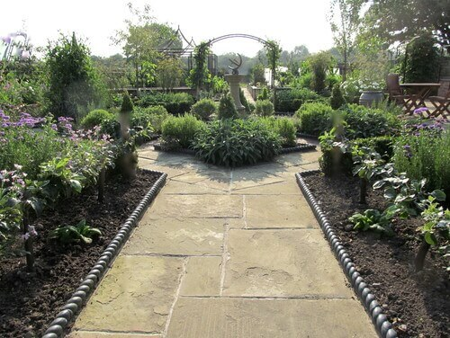 This stunning garden has a variety of different plants. Even a high end garden such as this benefits from including berry bushes among other kinds of plants.